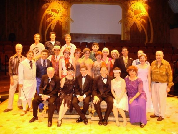 Director Mark Knowles with the cast of Singin' in the Rain